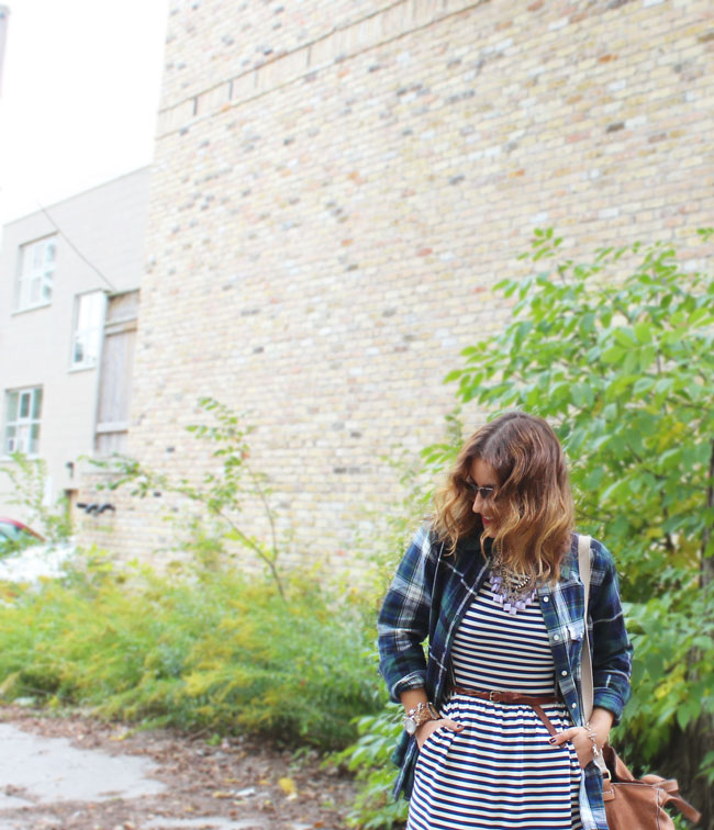 Pattern mixing for fall - plaid flannel button down and a striped dress