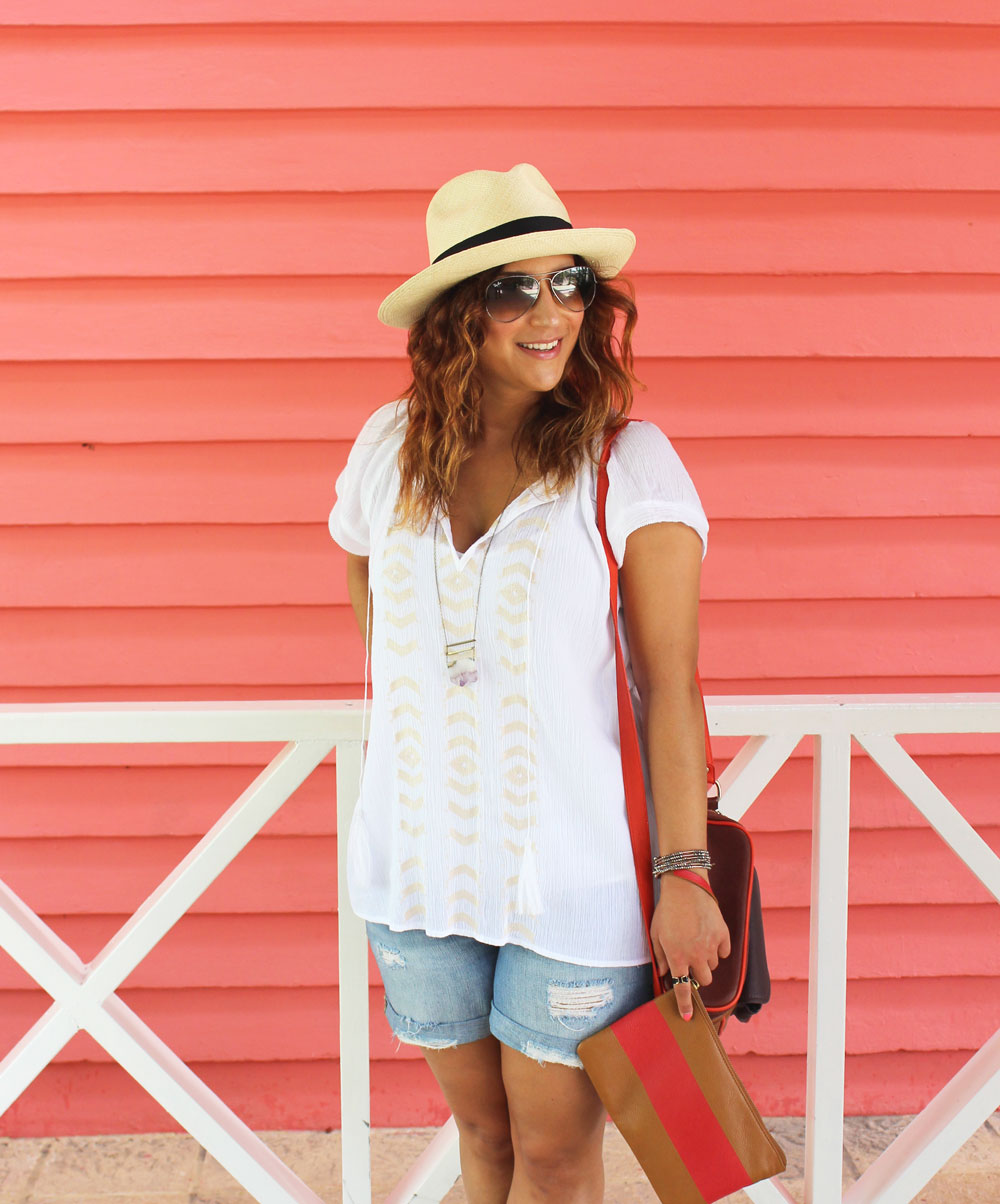 summer uniform: ripped denim shorts, a cute top and a panama hat