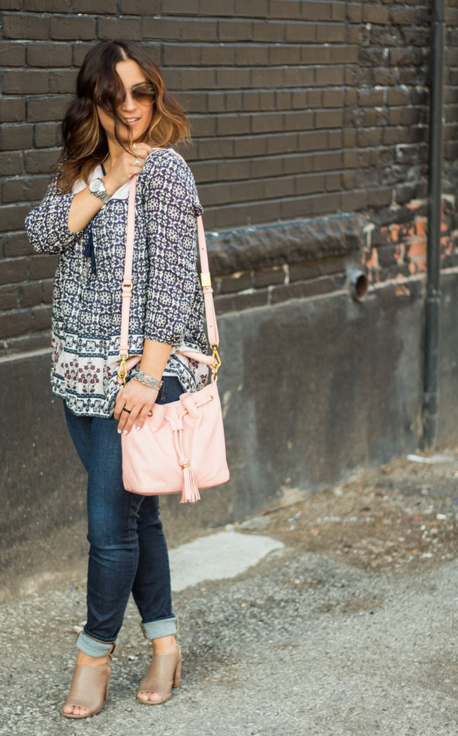 peasant top, skinny jeans, peep toe wedges and a pink bucket bag