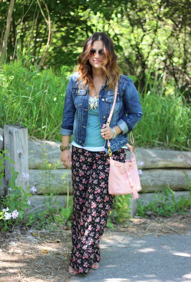 Floral palazzo pants, denim jacket, bucket bag