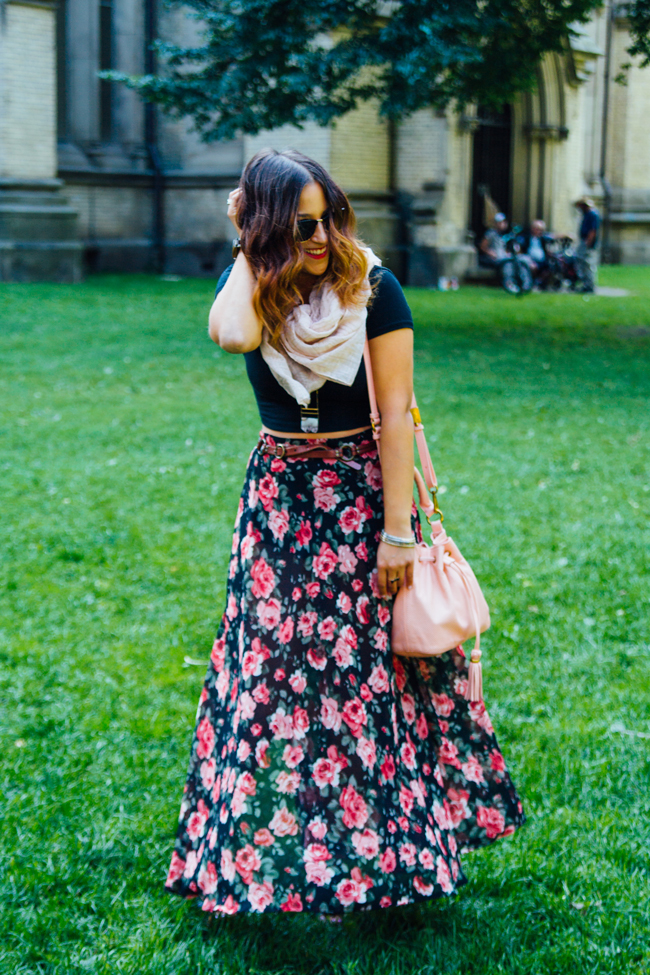 Toronto fashion blogger wears a crop top with a floral maxi skirt
