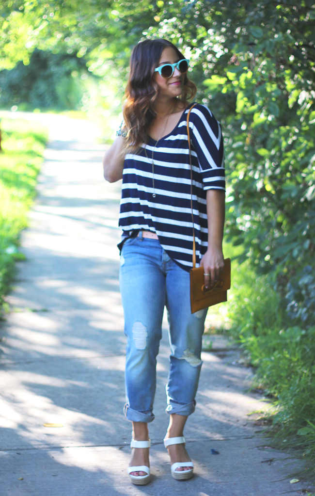 striped t-shirt, ripped boyfriend jeans and statement sunglasses