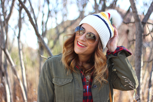 Hudson Bay toque, with plaid and a military jacket
