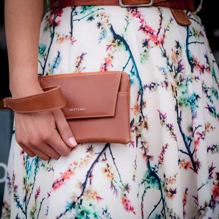 Matt & Nat vegan leather clutch, worn with a floral printed dress for the lemonberry spring shoot