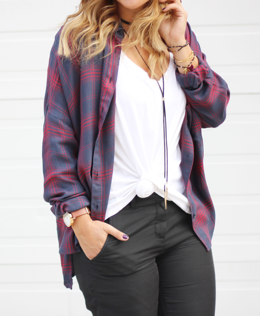 Long choker necklace, oversized plaid flannel shirt and a tied tank top