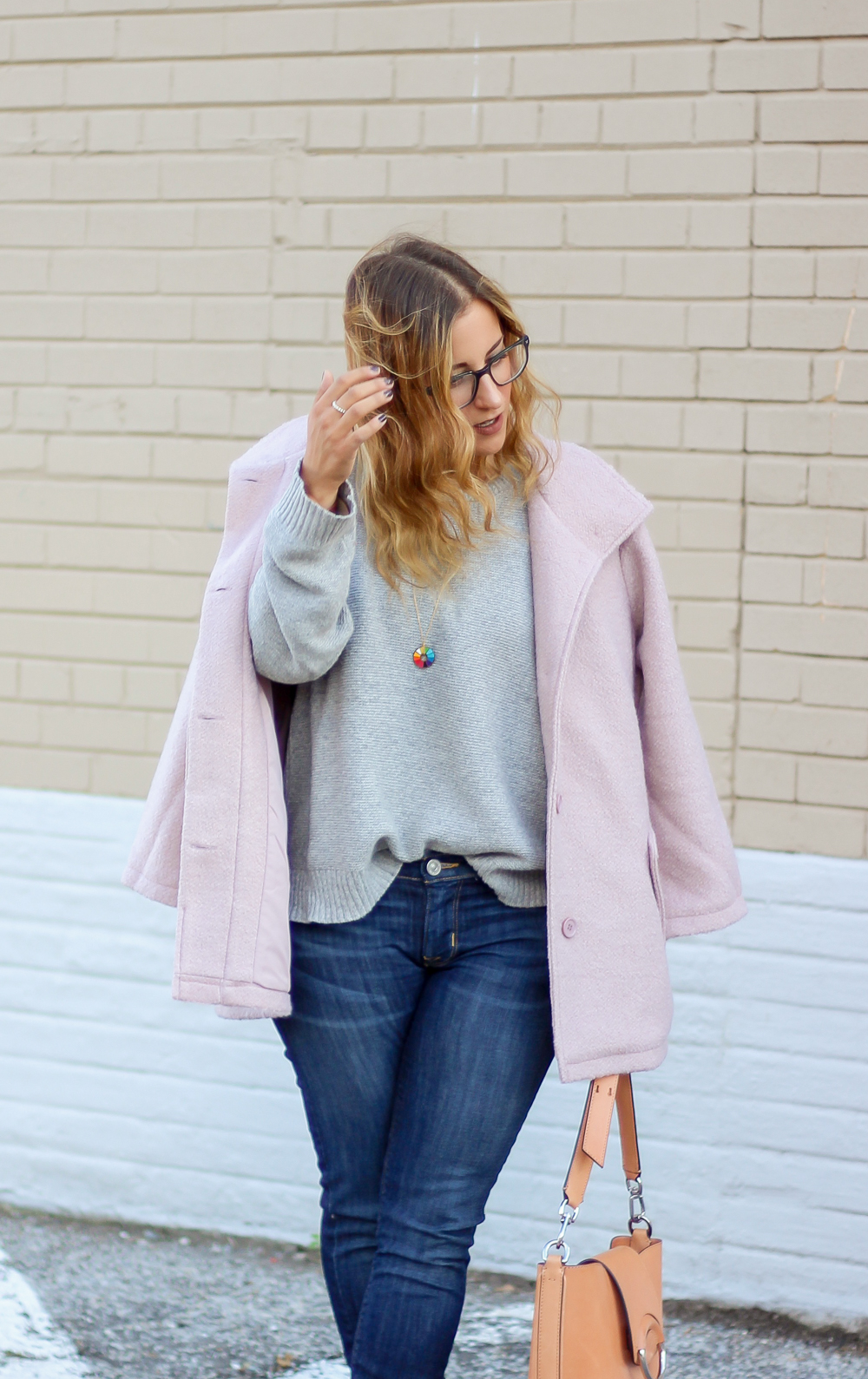 Toronto Fashion blogger, Jackie Goldhar, From Something About That styles a blush pink coat for fall with dark skinny jeans