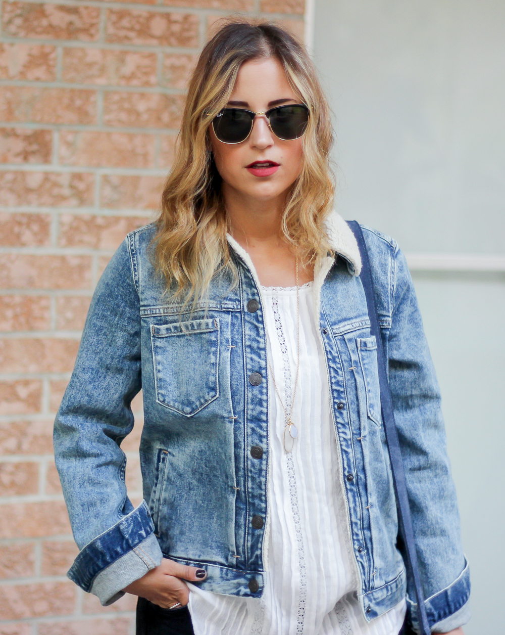 Toronto fashion blogger, Jackie Goldhar, shows you how to wear a denim sherpa jacket for women