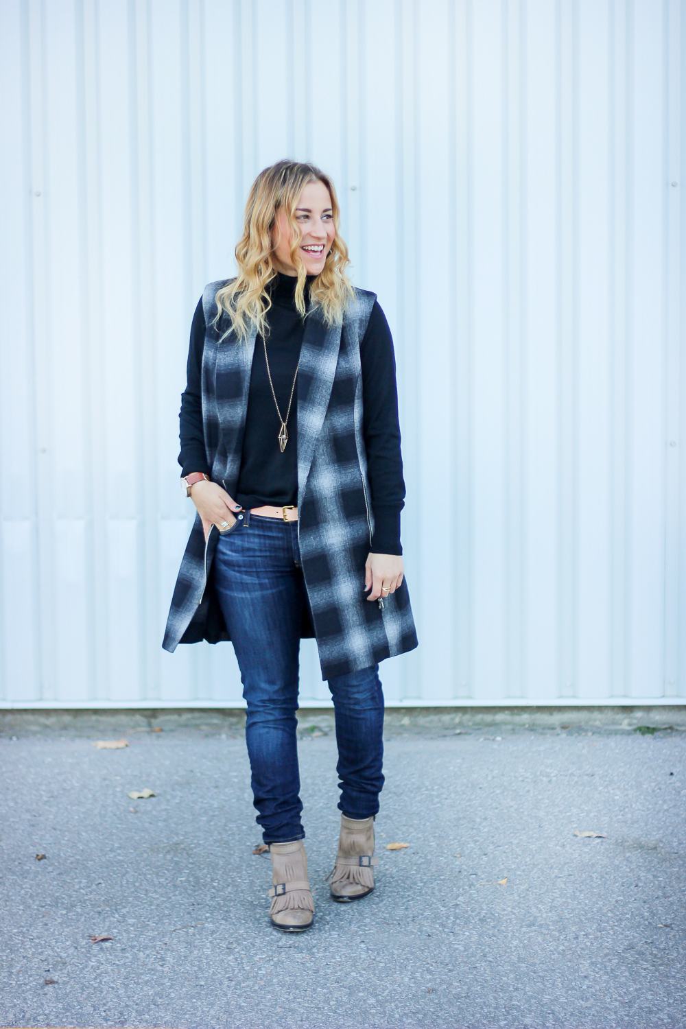 Toronto fashion blogger, Jackie Goldhar, wearing a Gap turtleneck, WAYF vest and Hudson jeans