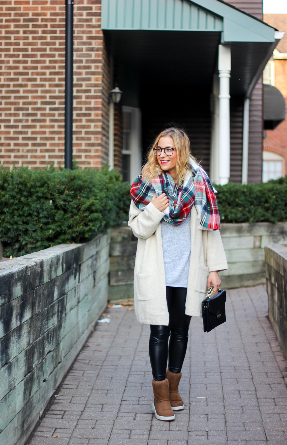 Toronto fashion, beauty and lifestyle blogger wears a plaid blanket scarf, Gap cardigan, Wilfred Faux Leather leggings and Ecco Ukiuk boots