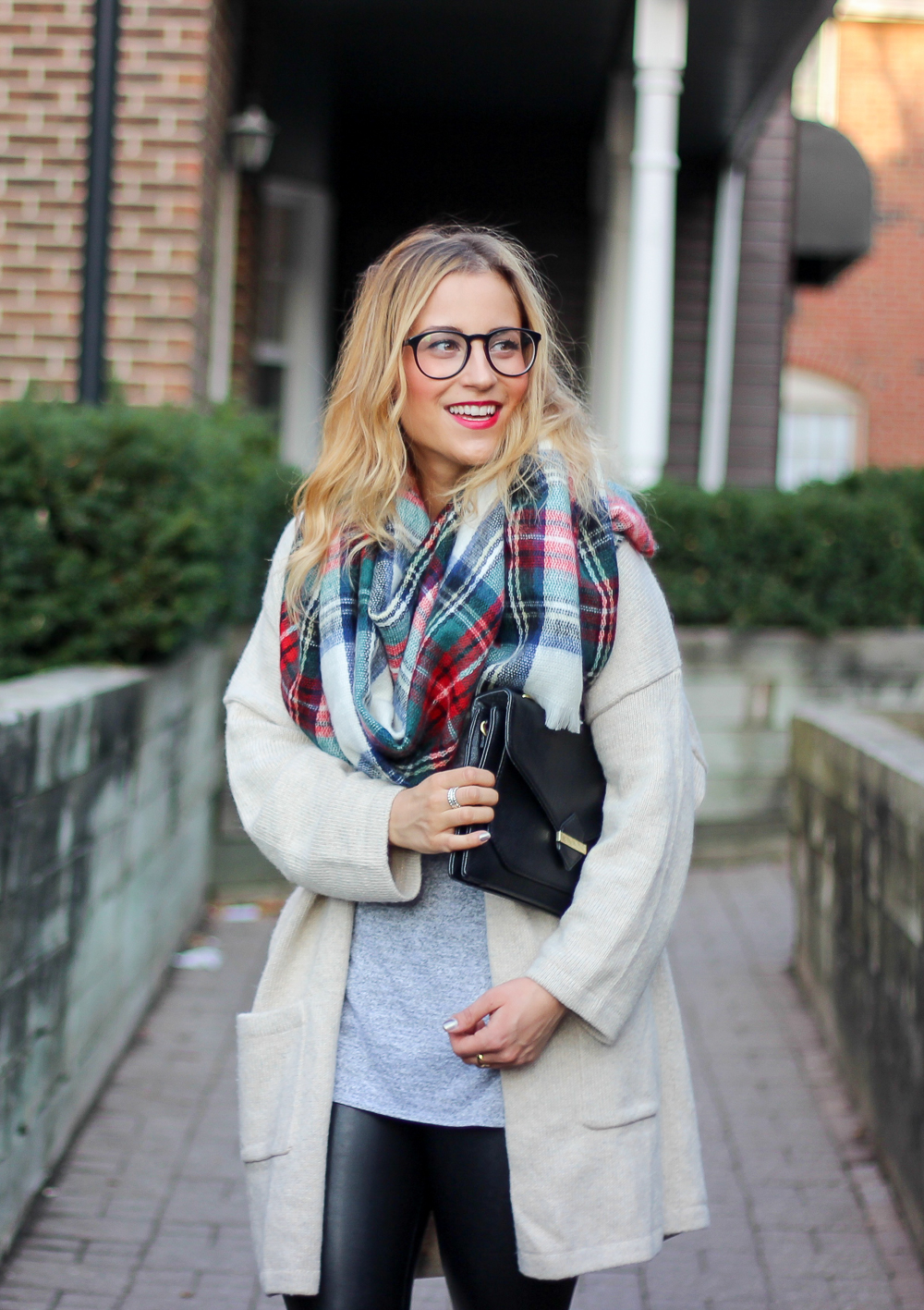 Jackie Goldhar is a Toronto-based fashion, beauty and lifestyle blogger, wearing a plaid blanket scarf and an oversized cardigan for the fall