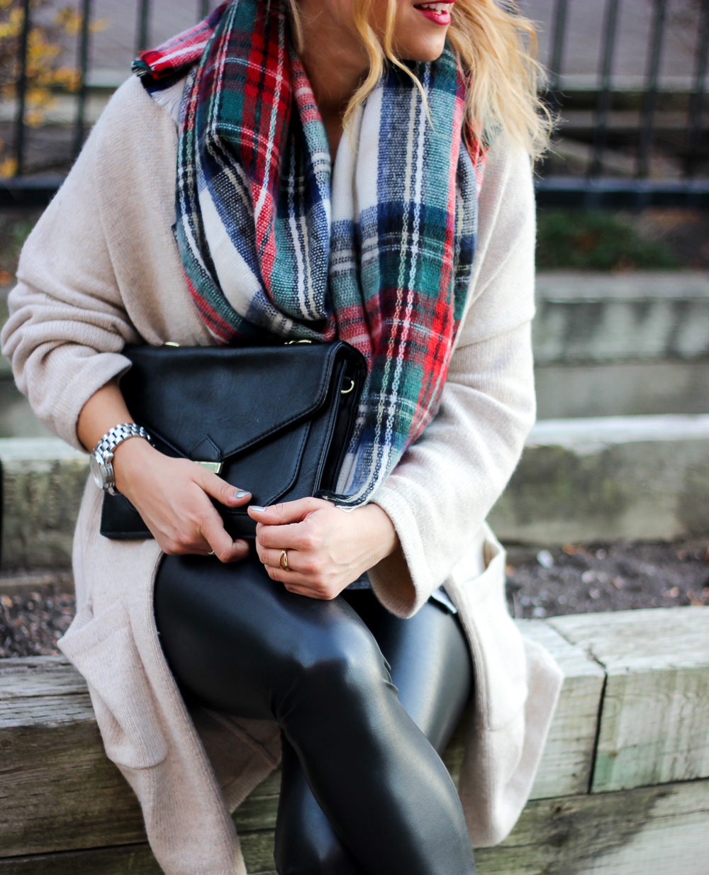 An easy weekend outfit for fall and winter, with a plaid blanket scarf, cozy cardigan and faux leather leggings