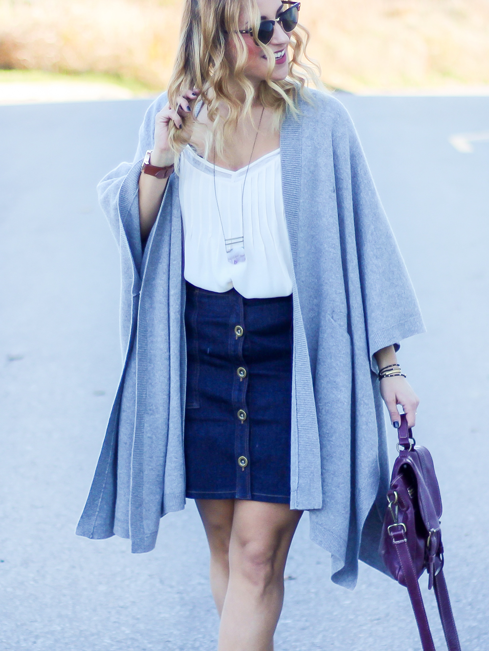 Fall outfit idea, featuring a denim skirt from Banana Republic and poncho from Aritzia, seen on Toronto fashion and lifestyle blogger, Jackie Goldhar, from Something About That
