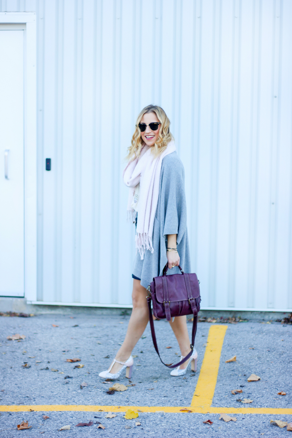 "Toronto fashion blogger, Jackie Goldhar, wears a light pink boucle scarf from Indigo, grey Aritzia poncho and the Nine West ""Viper"" T-strap Mary-Jane pumps"
