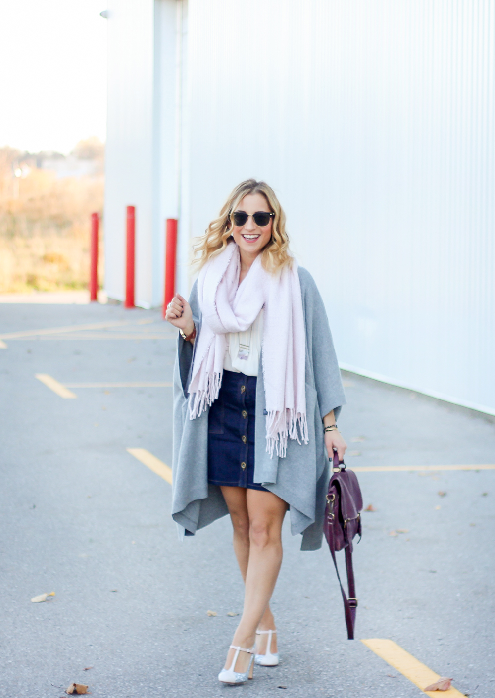 Fall outfit idea - wearing a poncho from Aritzia, Banana Republic Button Front Skirt, and pink scarf from Indigo