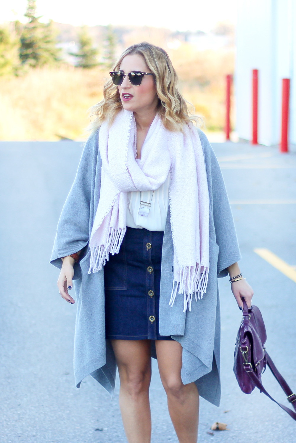 Light pink boucle scarf from Indigo, paired with a denim button front skirt from Banana Republic and a grey Aritzia poncho cardigan