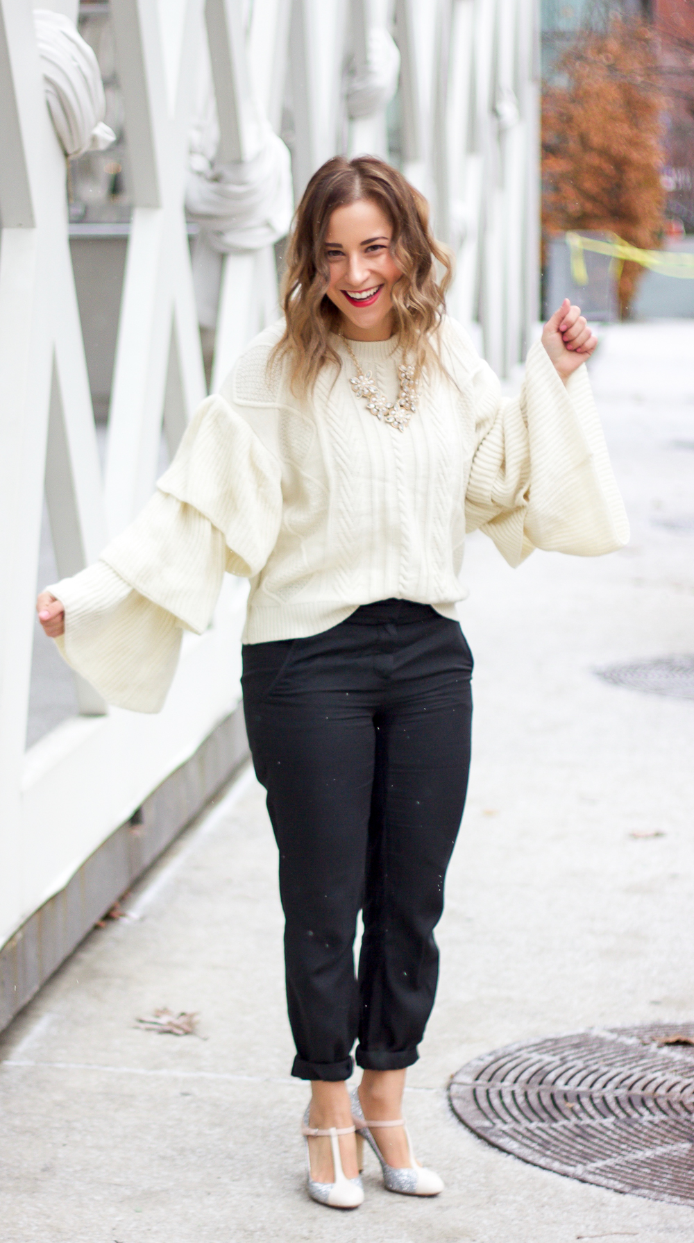 Canadian fashion and lifestyle blogger, Jackie Goldhar from Something About That, wearing Chicwish Ivory Cable Knit Tiered flare sleeve sweater and Aritzia trousers