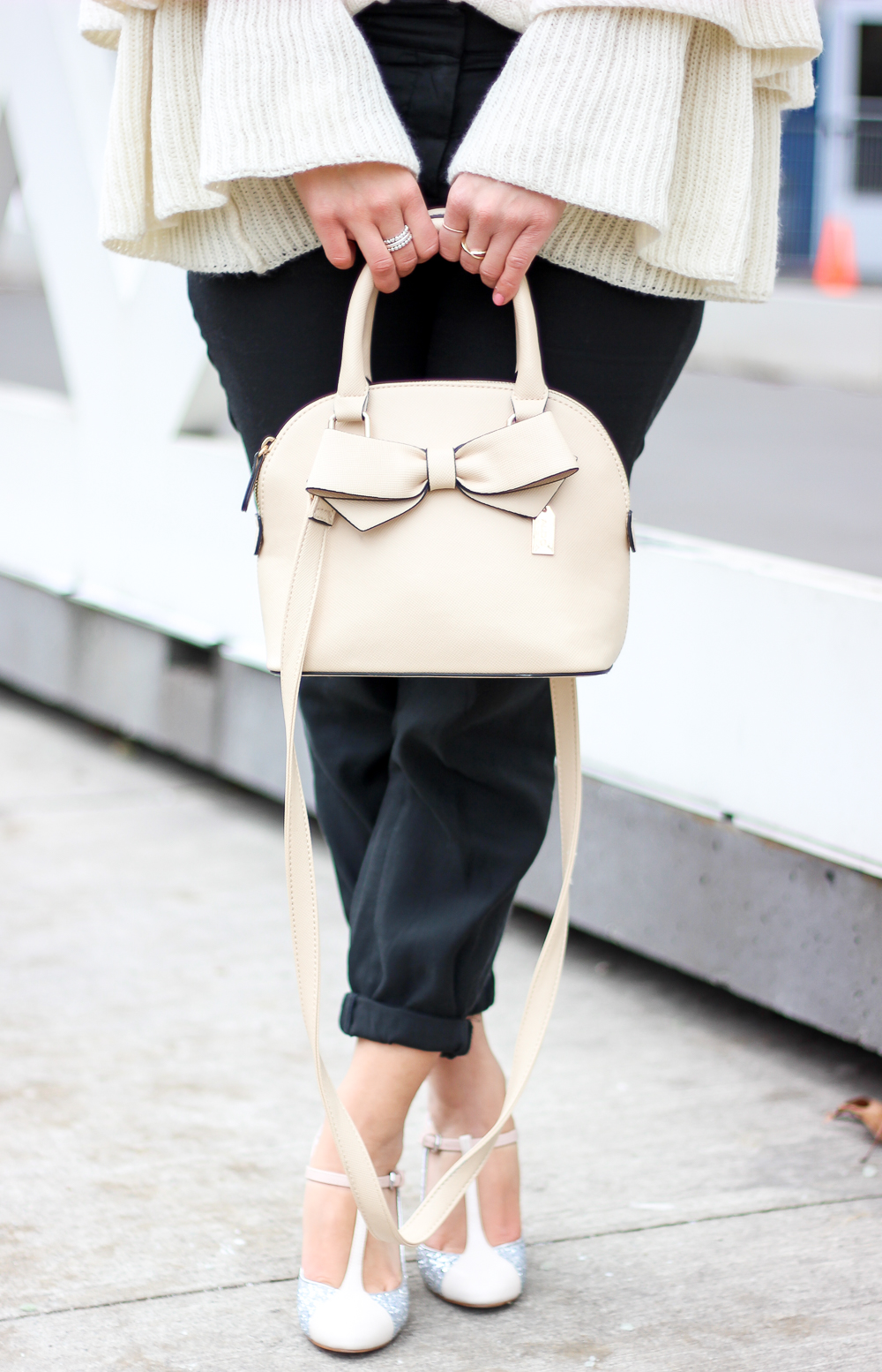 Pastel pink purse with a bow on the front from Aldo Accessories is an affordable alternative to a Kate Spade bag