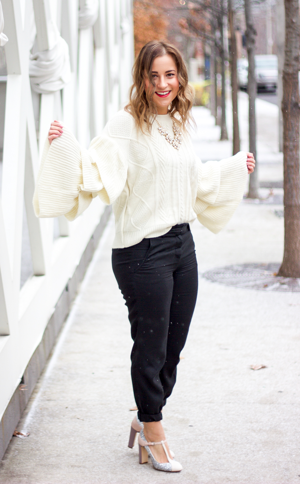 Chicwish tiered flare sleeve sweater and Aritzia dress pants, worn by Toronto fashion blogger, Jackie of Something About That