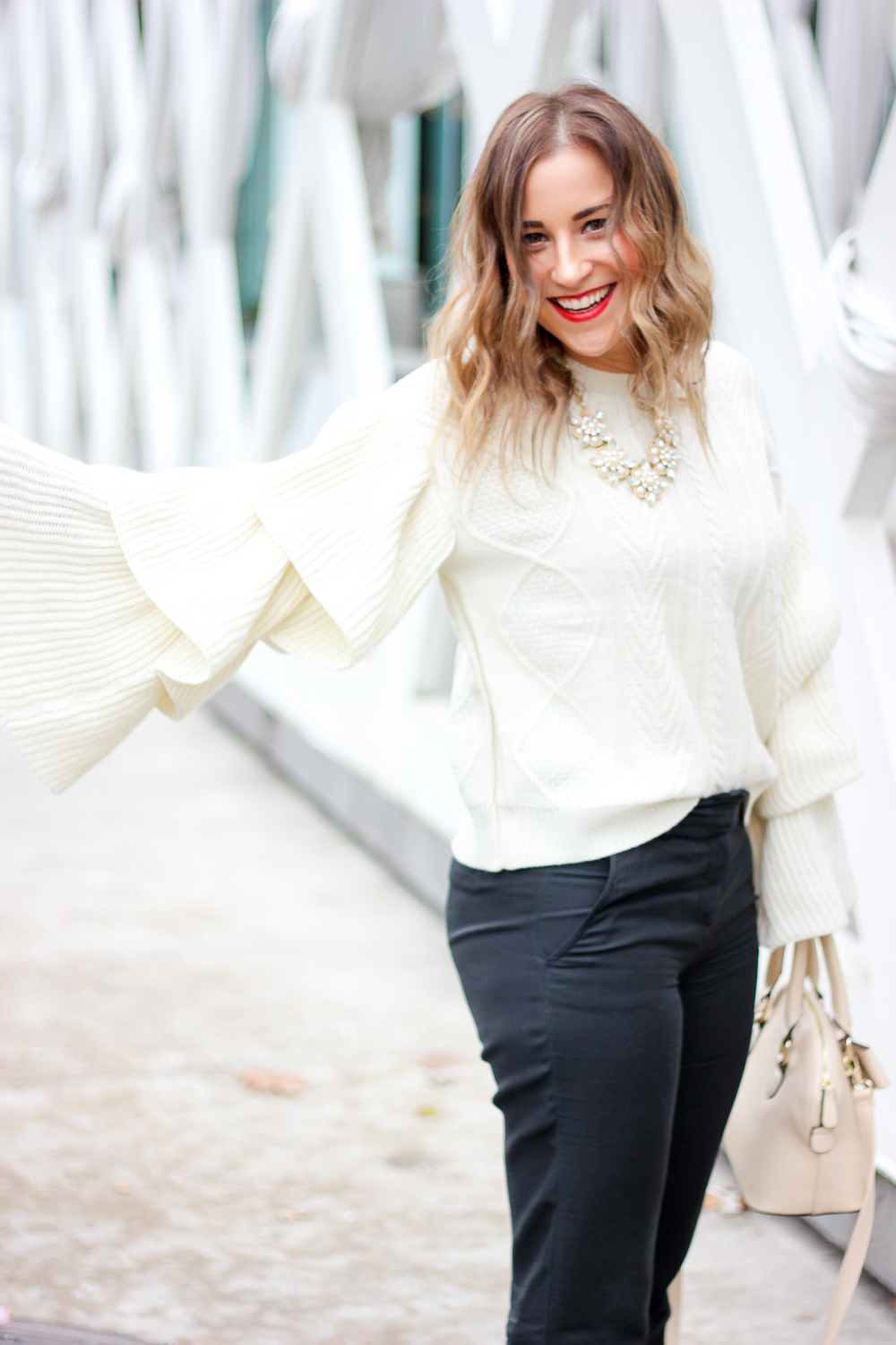 Toronto fashion blogger wearing a Chicwish winter cable knit sweater with tiered flare sleeves as outfit inspiration for cold weather