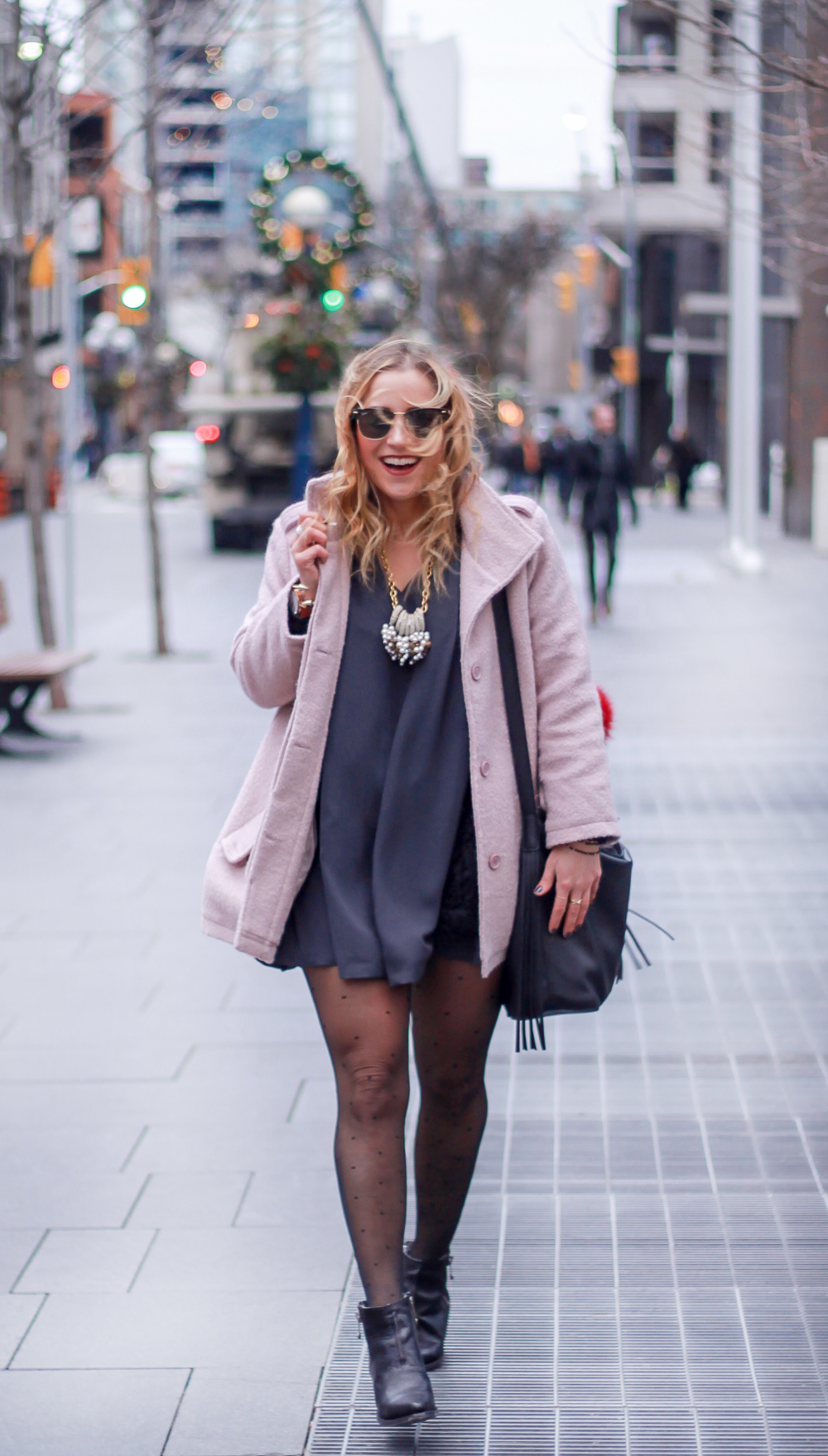 Toronto fashion blogger, Jackie Goldhar wearing a holiday outfit, featuring a pink cupcakes and cashmere coat and pink martini dress
