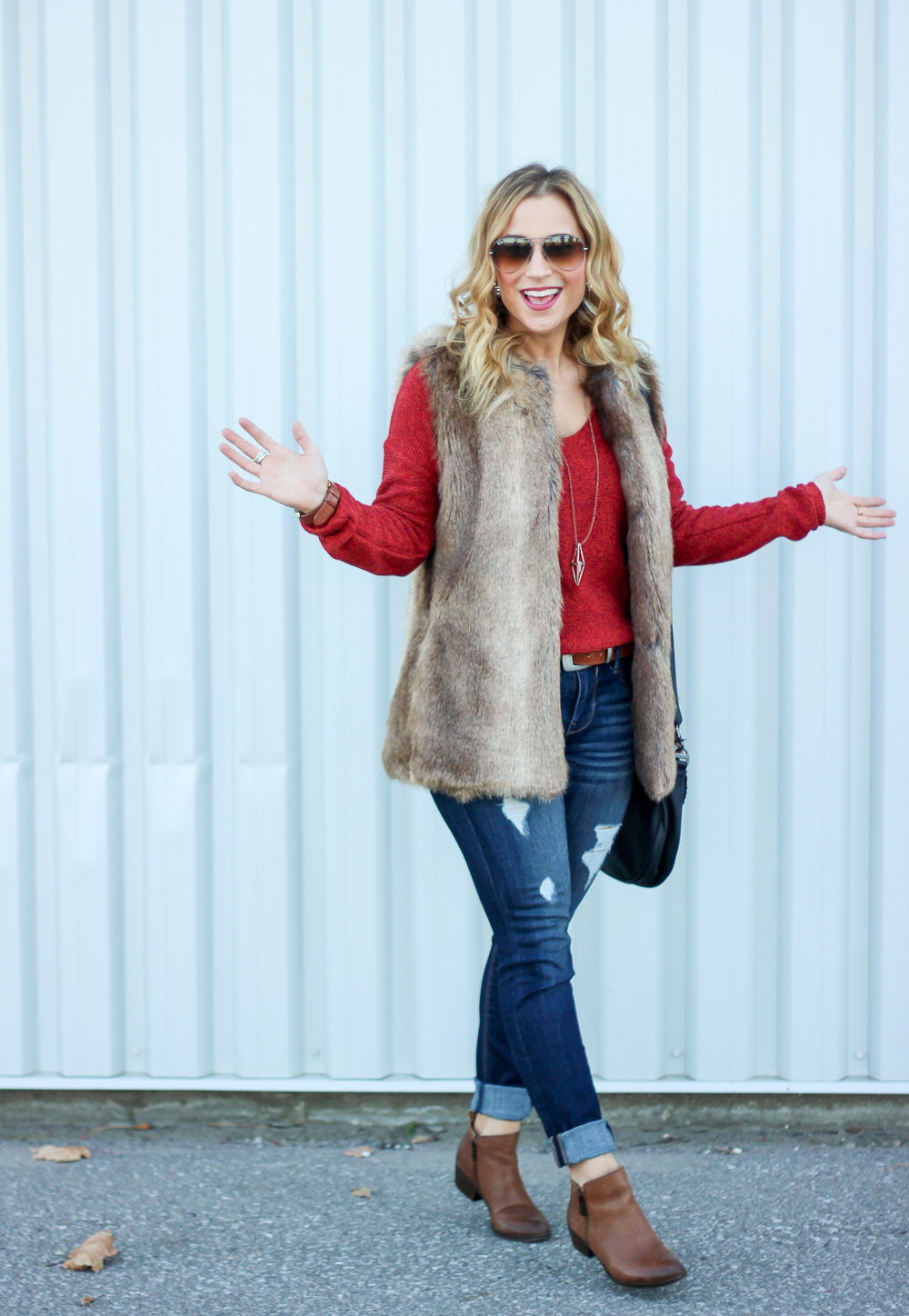 Canadian fashion blogger shows off a fun, casual outfit for the fall or winter, wearing an Old Navy sweater and a faux fur vest with jeans