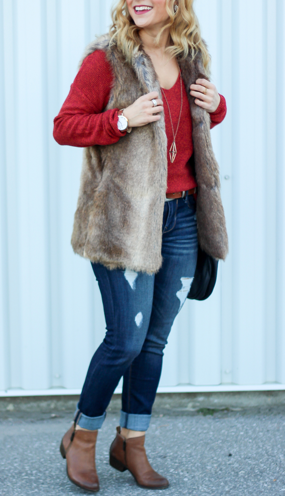 Canadian fashion blogger, Jackie Goldhar, from Something About That wears a faux fur vest from Zara, v-neck sweater from Old Navy and jeans from Express