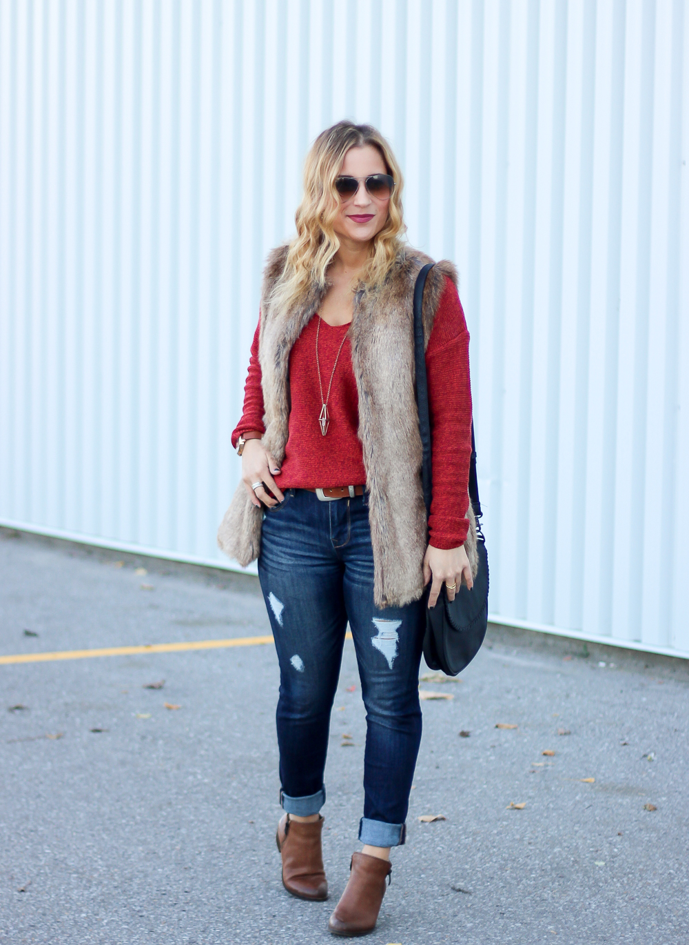 Toronto fashion and lifestyle blogger, Jackie Goldhar, wearing Zara faux fur vest, Old Navy sweater and Express Jeans