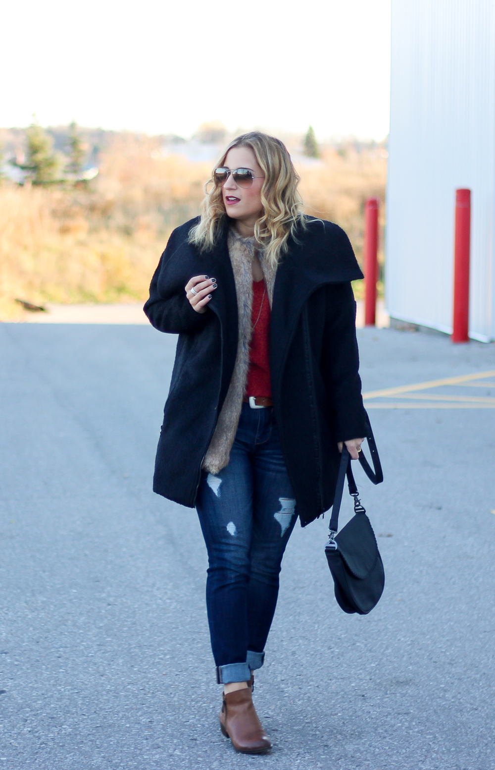 Canadian fashion and lifestyle blogger, Jackie Goldhar, sharing an outfit that features a Bench jacket with an exaggerated, oversized collar