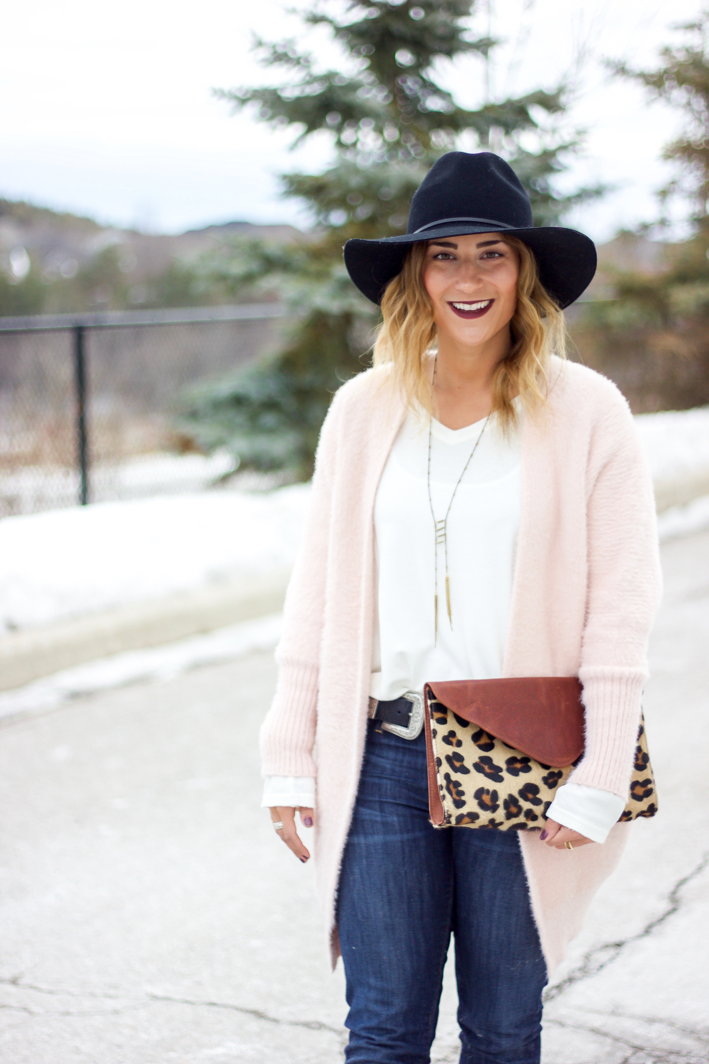 Jackie Goldhar is a top Canadian fashion and lifestyle blogger. She's wearing a chicwish cardigan, hat from Aritzia and leopard clutch from BRAVE Leather
