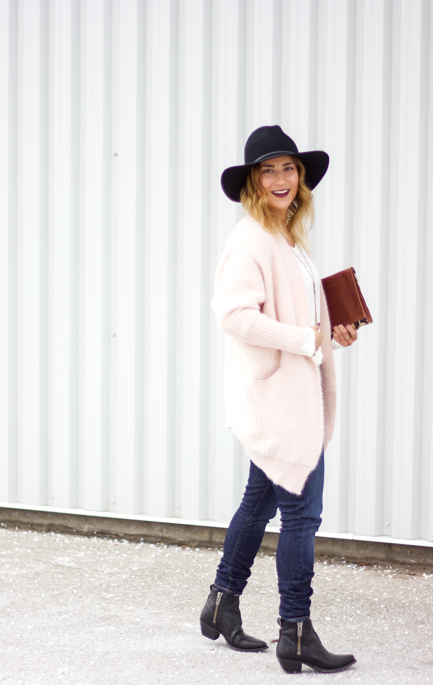 Jackie Goldhar is a top Toronto fashion and lifestyle blogger, who's wearing a fuzzy pink cardigan from Chicwish