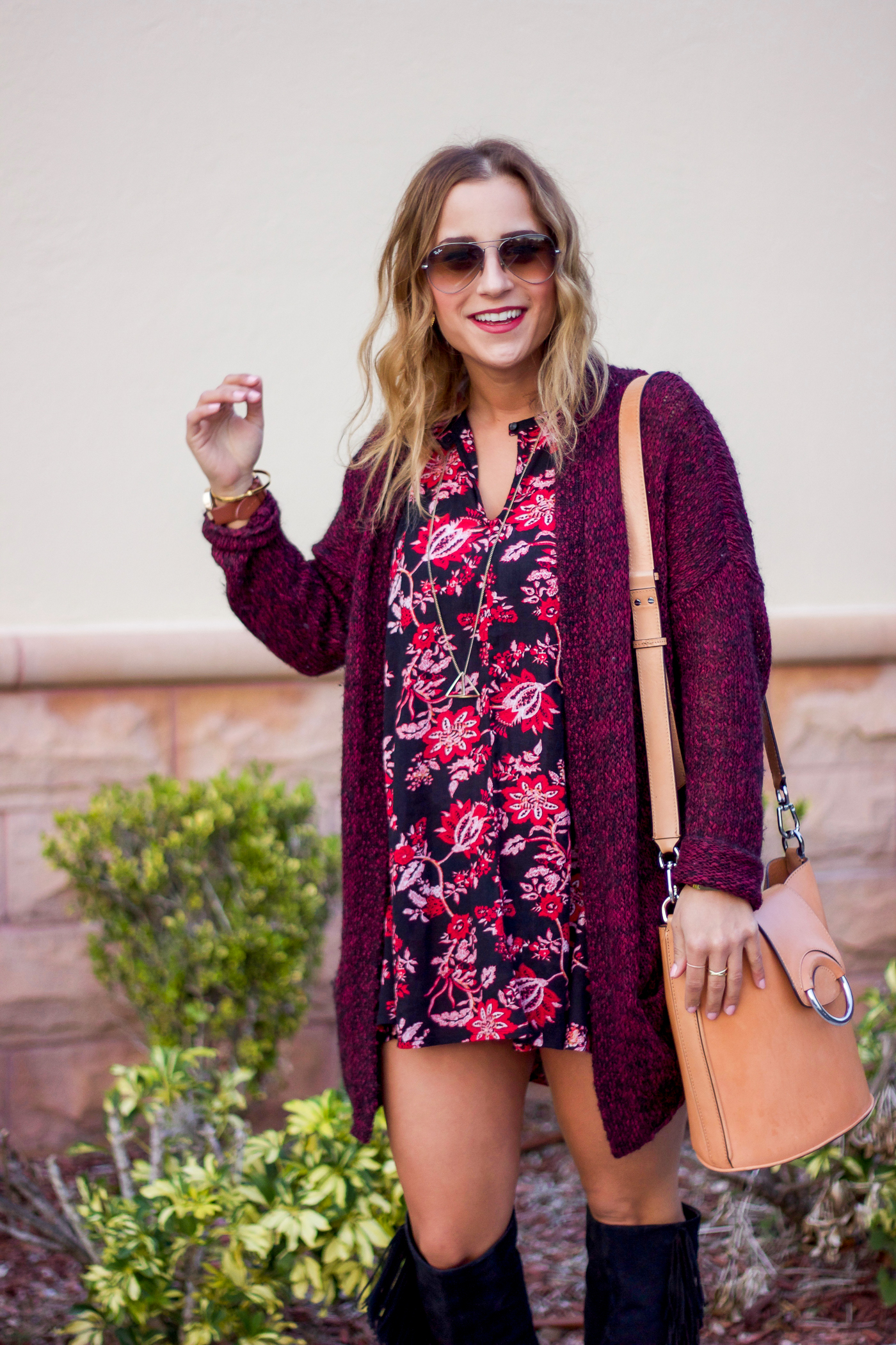 Canadian fashion blogger, Jackie of Something About That, is wearing a dark floral dress with a cardigan from Aritzia