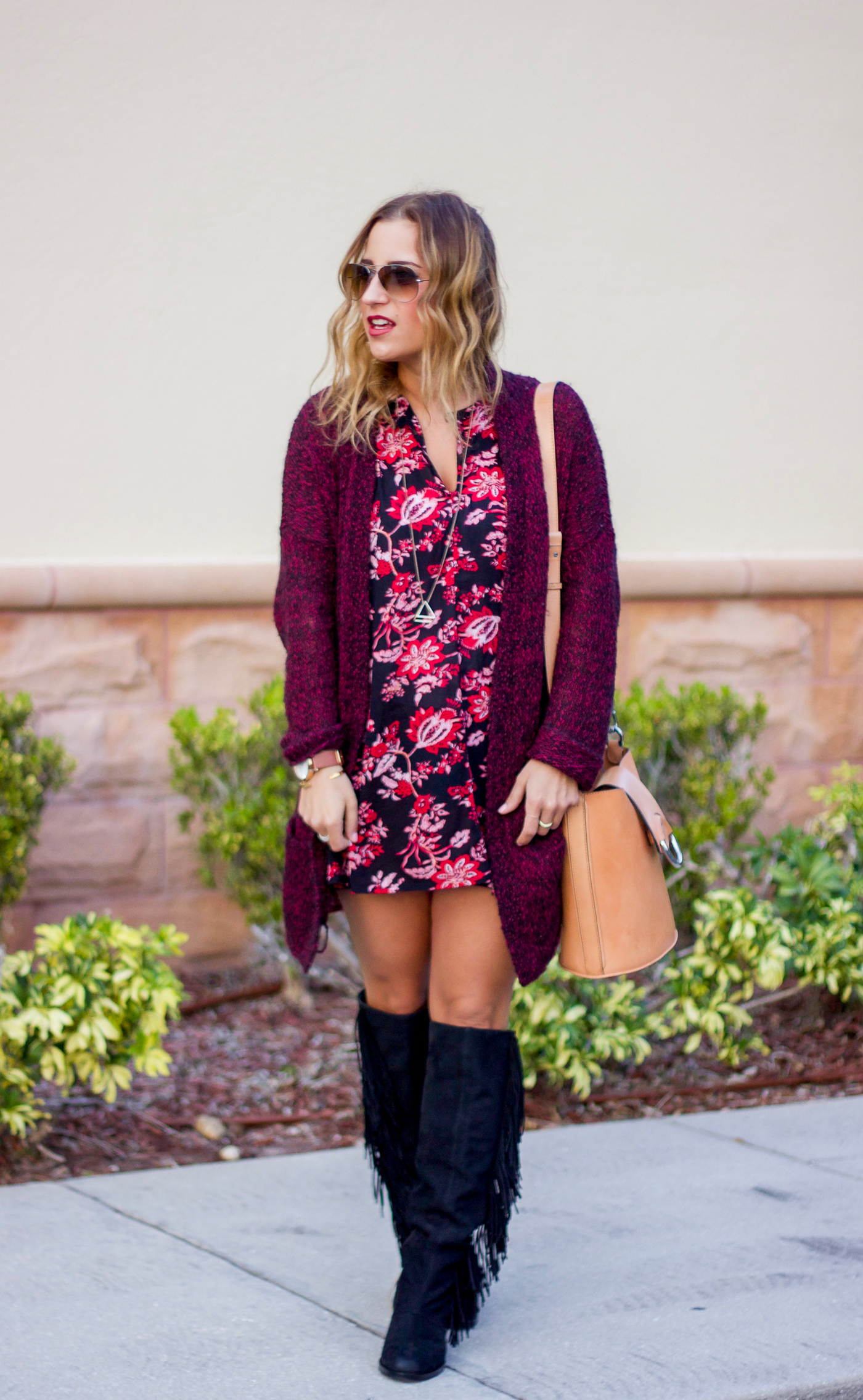 Canadian life and style blogger is wearing a dark floral dress with a cardigan from Aritzia on a trip to Florida