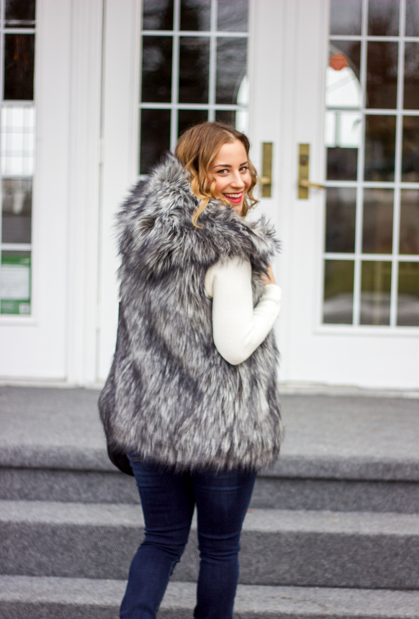 How to wear a faux fur vest with a hood
