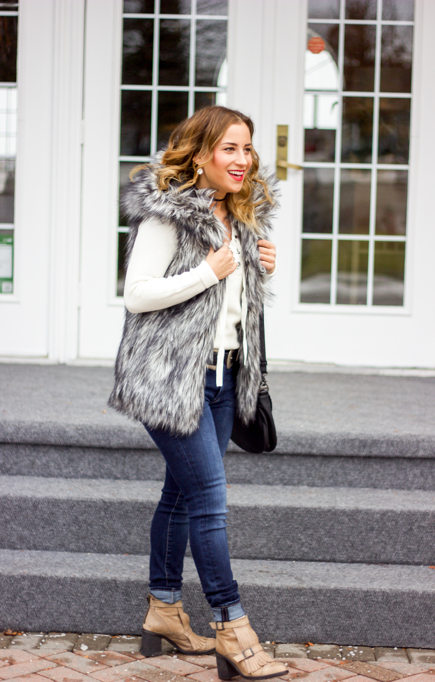 Canadian life and style blogger, Jackie Goldhar wearing a cozy winter outfit, with faux fur from Artizia and Fidelity denim jeans