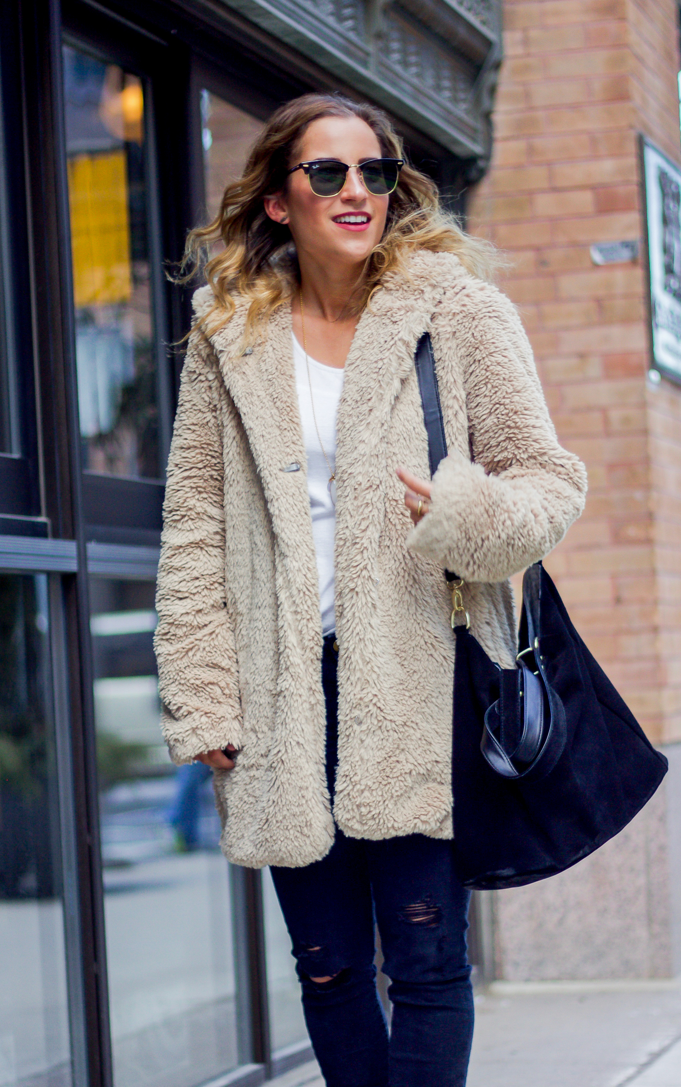 Toronto fashion and lifestyle blogger, Jackie Goldhar of Something About That, wearing a Gap sherpa coat for winter