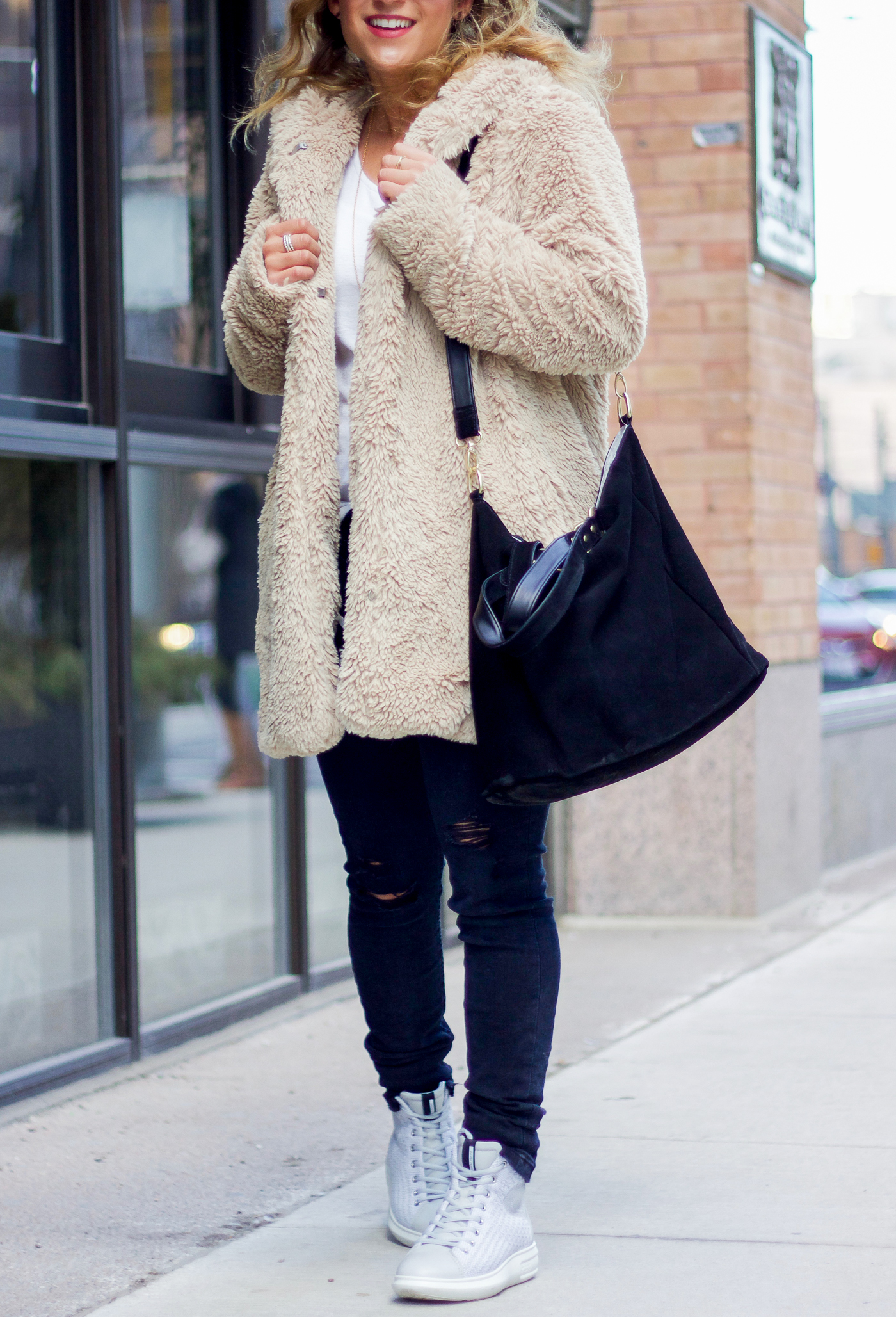 Toronto life and style blogger, Jackie Goldhar of Something About That is sharing a winter outfit idea, featuring Ecco Soft 3 High Top sneakers