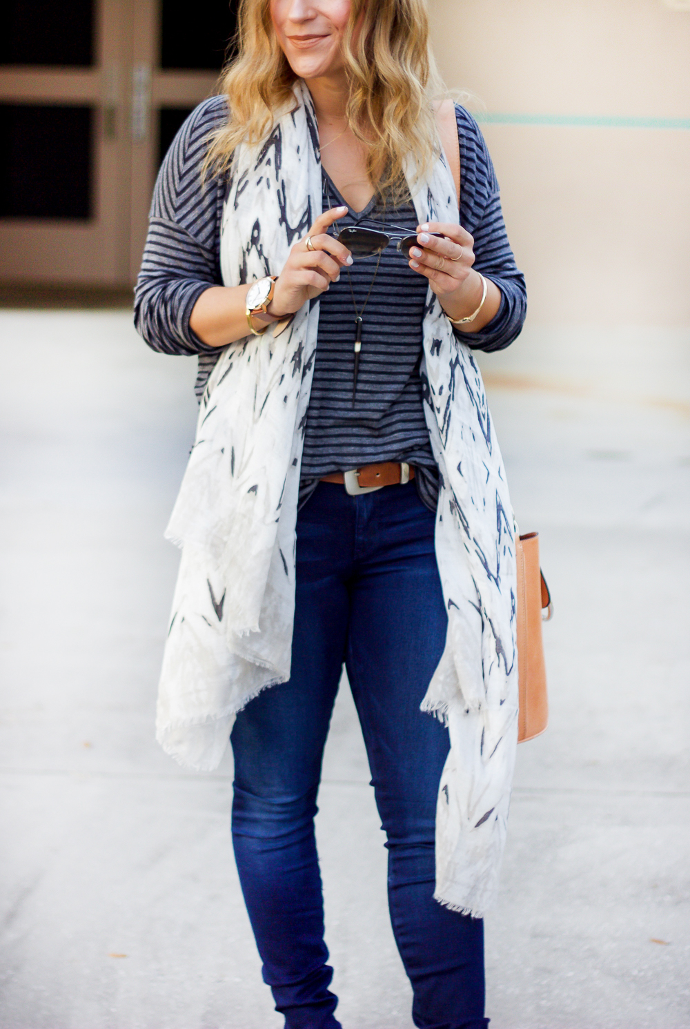 Canadian fashion blogger, Jackie of Something About That is wearing a casual outfit, featuring a tee from Madewell, a light scarf and GUESS jeans
