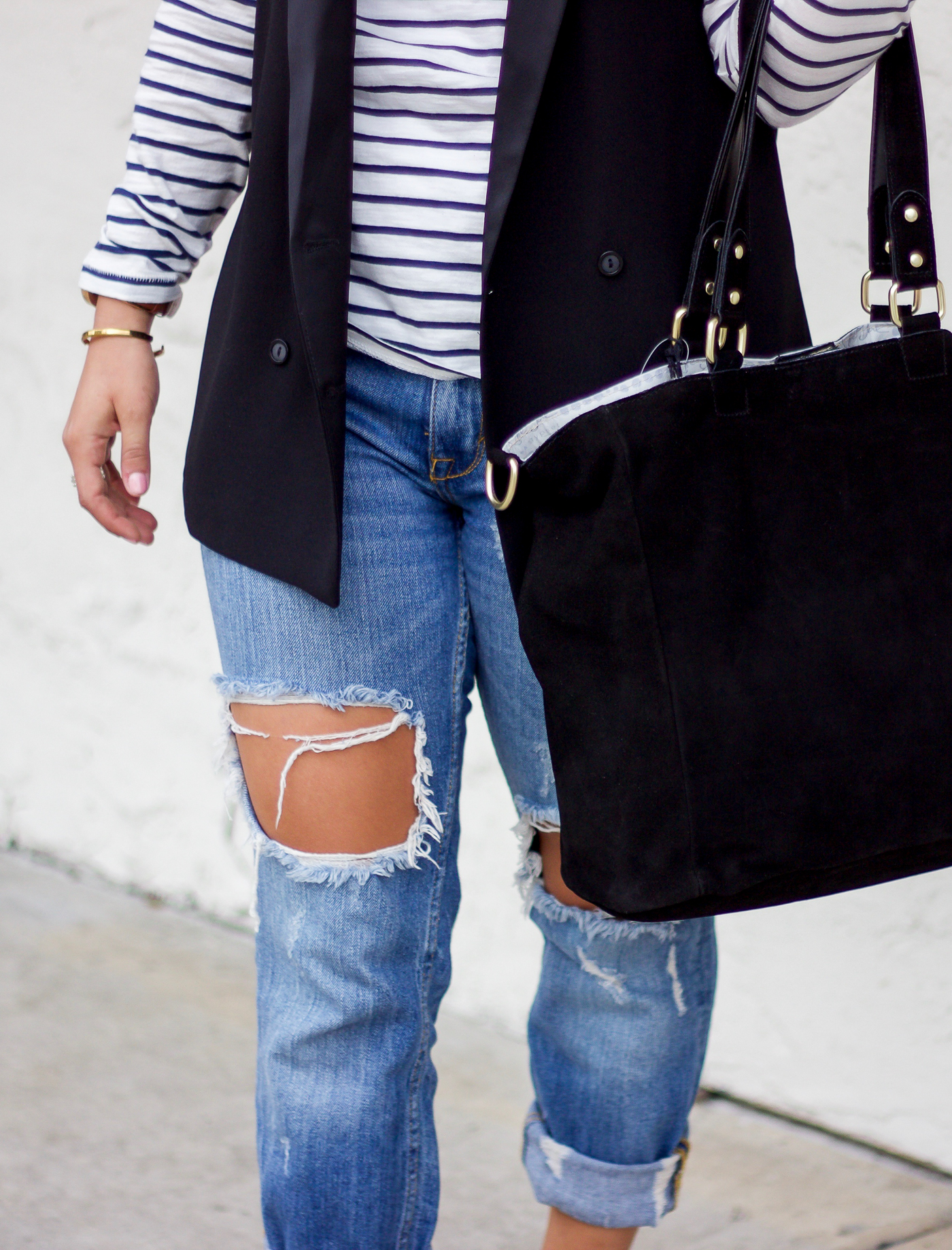 One of the top Toronto fashion blogger, Jackie Goldhar of Something About That, in ripped jeans and stripes