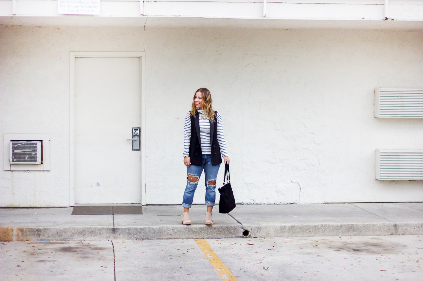 Weekend outfit inspiration, featuring a striped tee from Madewell and ripped boyfriend jeans from Zara
