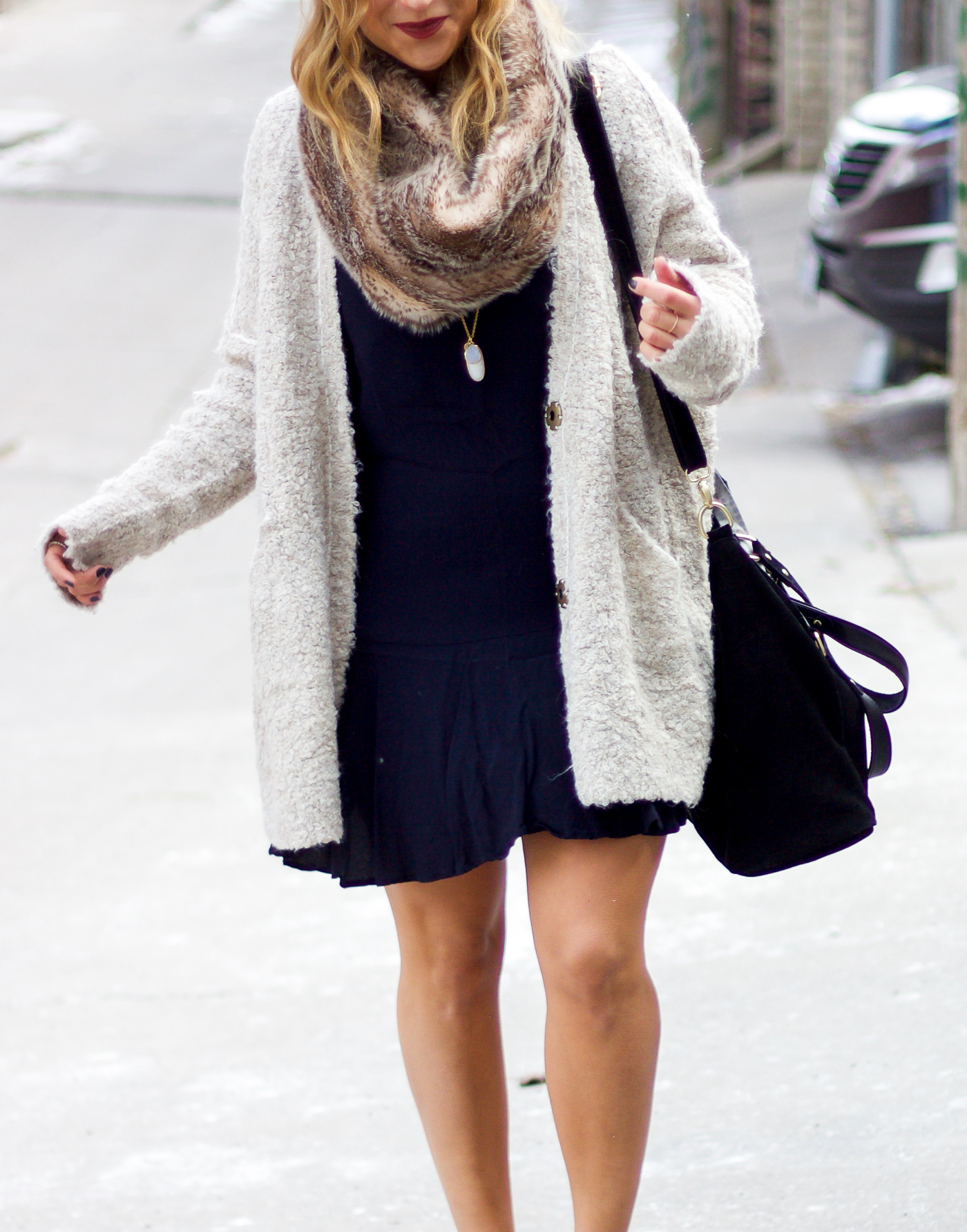 Canadian fashion blogger wearing a black dress from Gap and a Free People boucle cardigan
