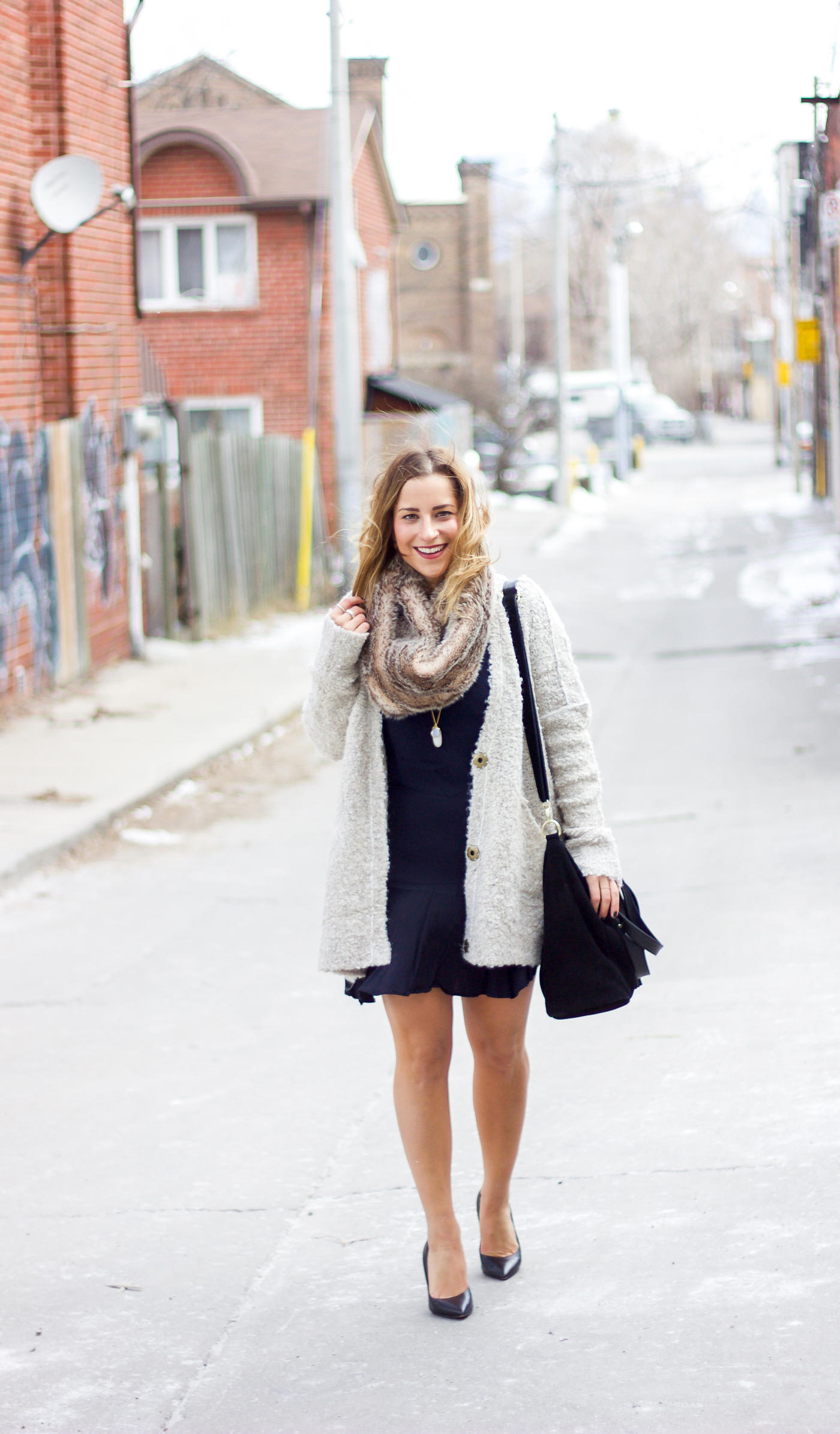Toronto lifestyle and fashion blogger, Jackie of Something About That is wearing her favourite Free People cardigan with a dress and faux fur scarf