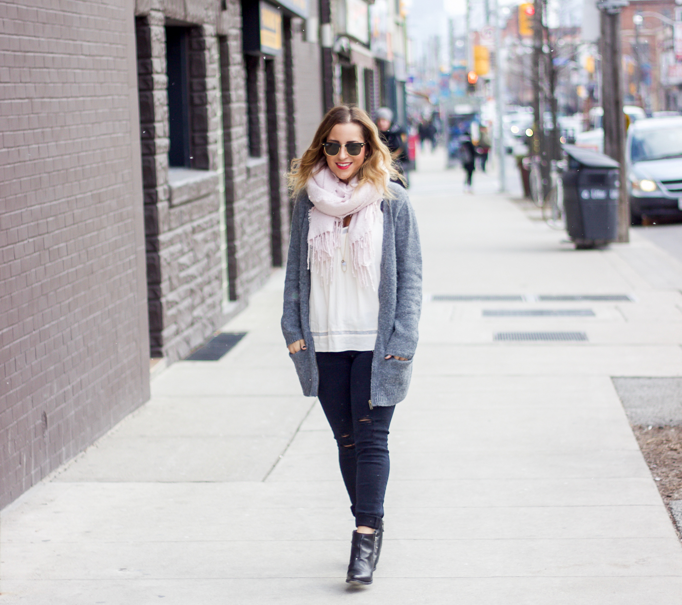 Toronto life and style blogger, Jackie Goldhar is wearing an Old Navy cardigan, pink scarf from Indigo and black skinny jeans from Zara