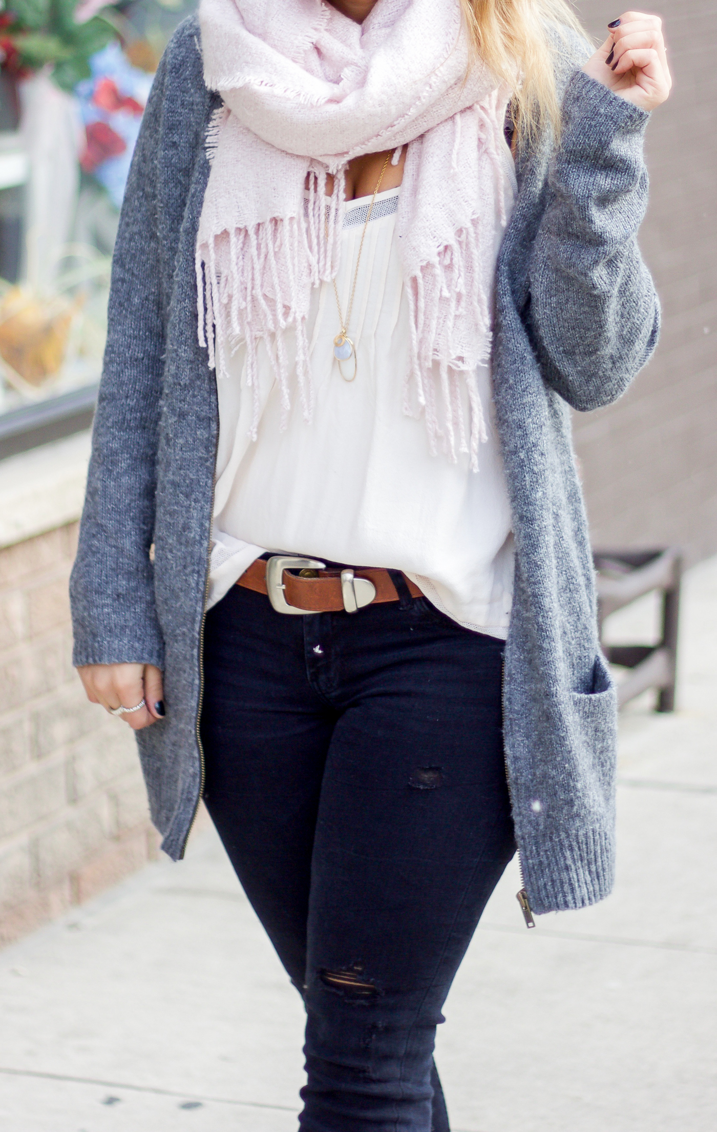 Canadian fashion blogger is wearing a cardigan from Old Navy, pink boucle scarf from Indigo and black jeans from Zara