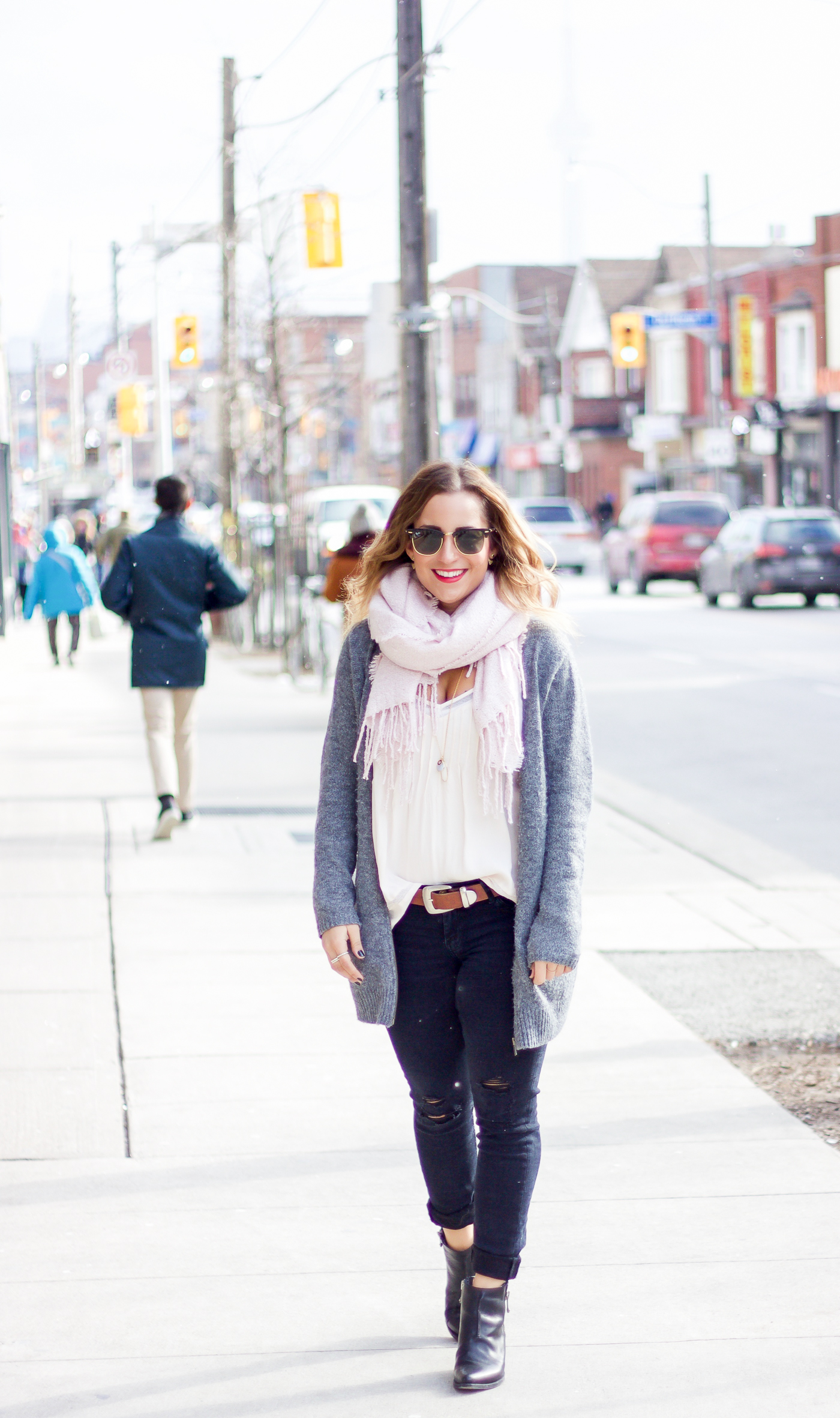 Toronto life and style blogger, Jackie Goldhar, is wearing a cardigan from Old Navy, pretty pink boucle scarf from Indigo and ripped jeans from Zara
