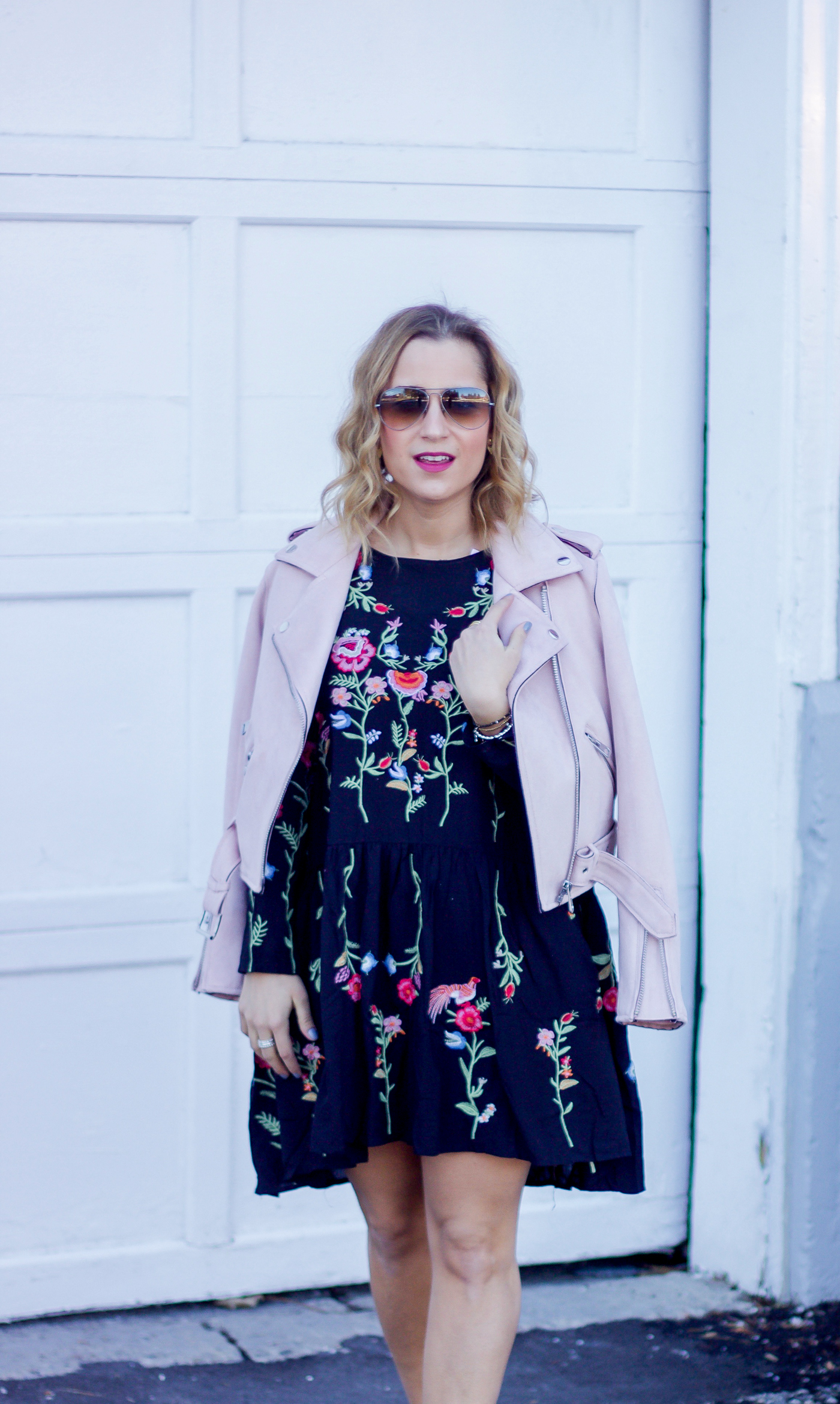 Toronto fashion and lifestyle blogger is wearing a floral dress from Chicwish