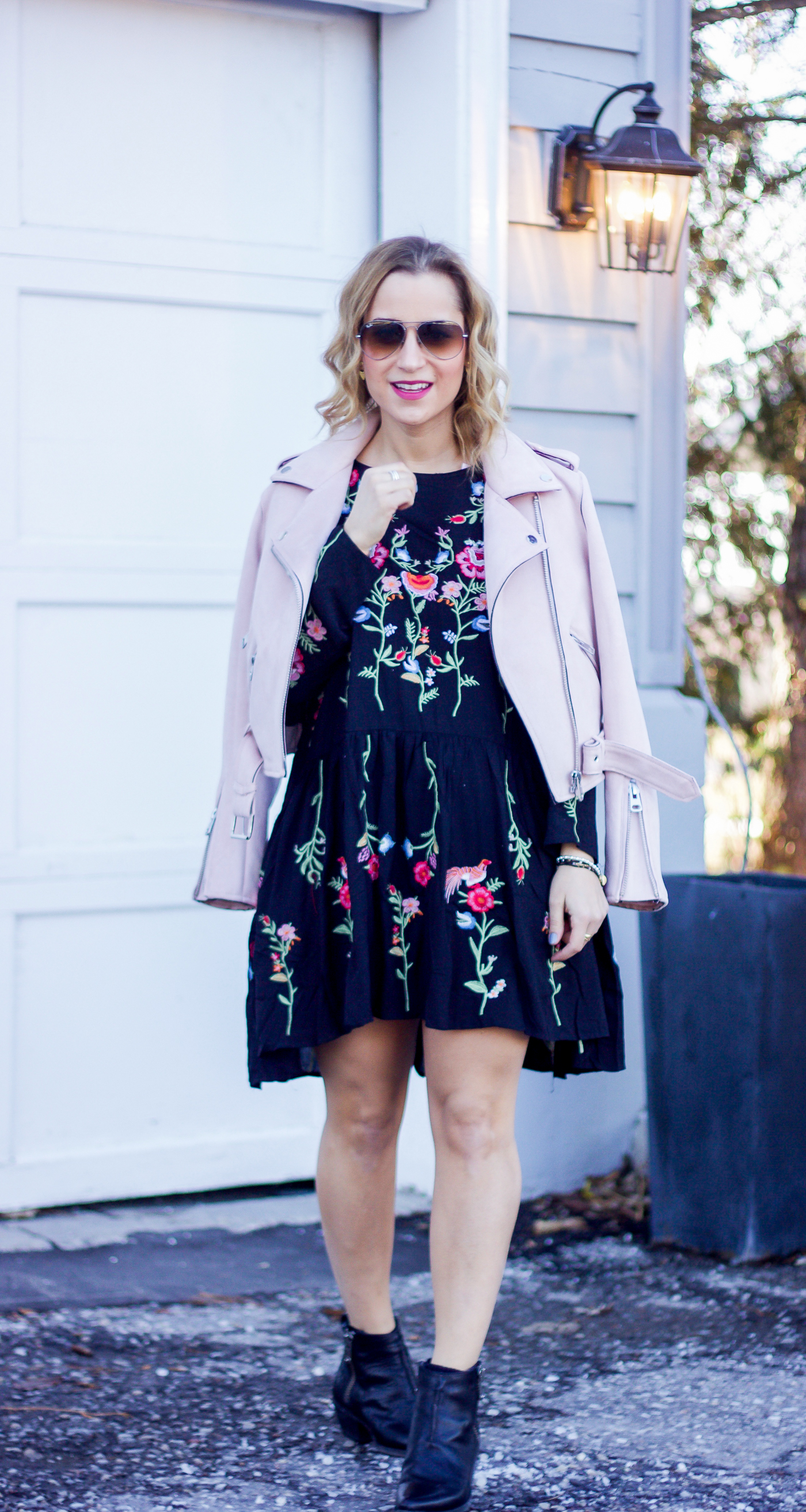 Canadian life and style blogger, Jackie of Something About That is wearing a pastel pink motorcycle jacket from Zara with a floral embroidered dress from Chicwish