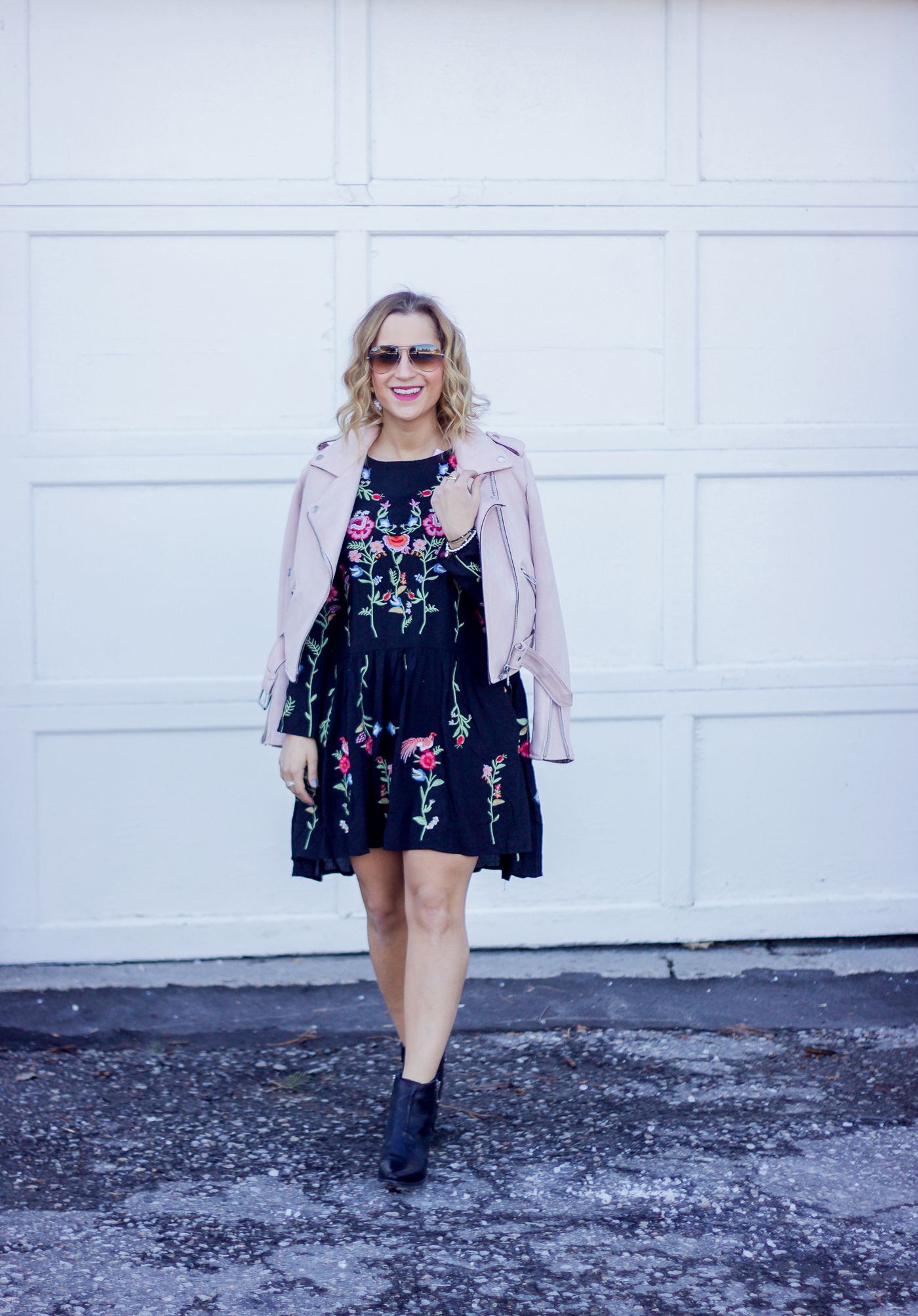 Spring outfit idea, featuring some fashion blogger staples - the suede moto jacket and floral dress