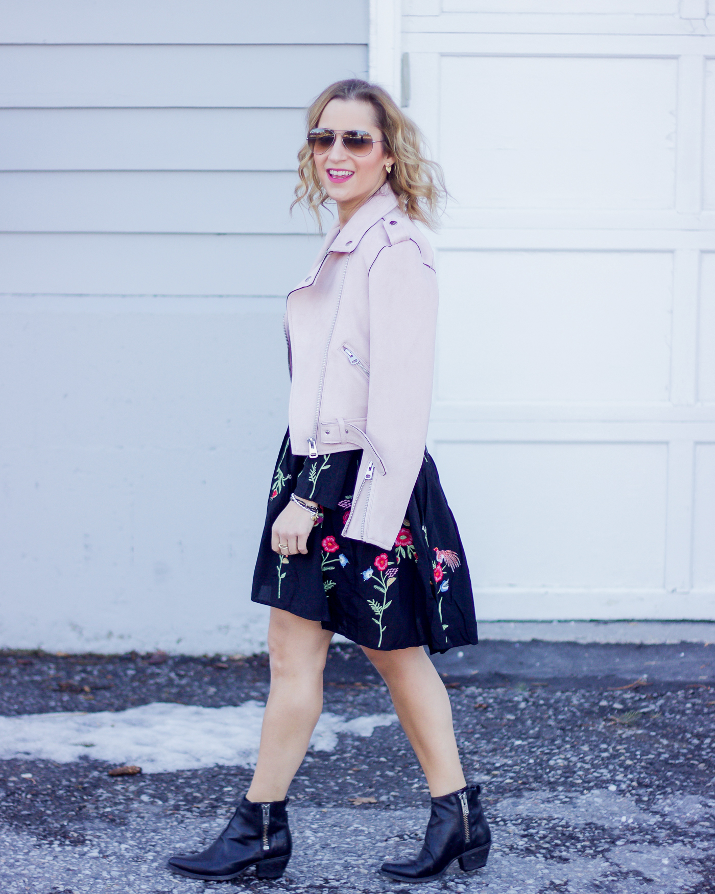 Toronto blogger, Jackie of Something About That is wearing a spring outfit, featuring a pastel pink moto jacket that is a blogger must-have