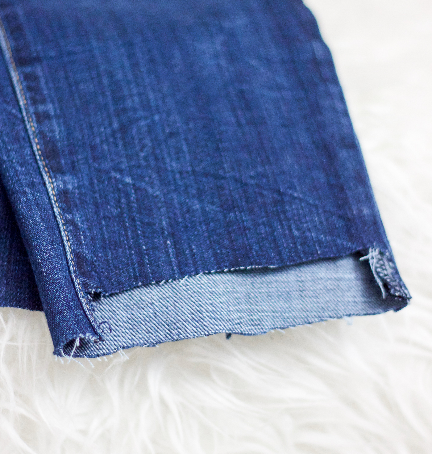 A quick and easy tutorial for how to DIY step-hem jeans yourself