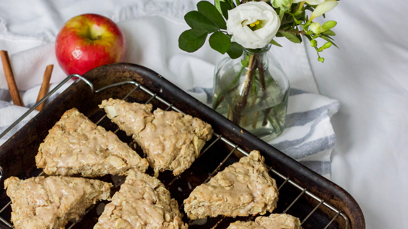 Delicious recipe for oatmeal cinnamon apple scones with a cinnamon glazed icing on top